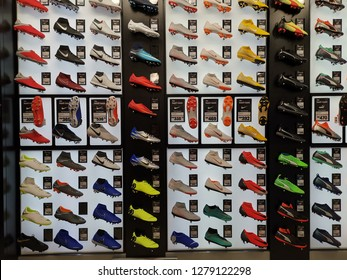 Kuala Lumpur, Malaysia - 08 January 2019: Various model of soccer boots and futsal shoes on display in local sports outlet