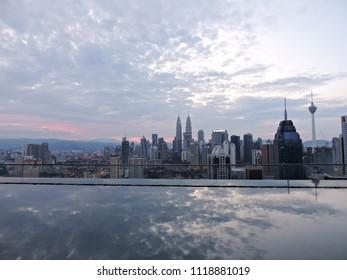 Kuala Lumpur, Malaysia - 09 11 2016: Beautiful skyline of Kuala Lumpur reflecting in the hotel pool