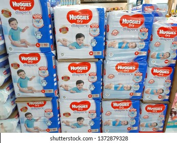 Kuala Lumpur, Malaysia - 09 April 2019 : Lots of packed baby pampers brand HUGGIES DRY display on supermarket shelves.