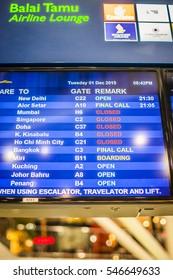 Kuala Lumpur, Malaysia - 1 December, 2015: Departure boards listing flight numbers, gates and times at Kuala Lumpur International Airport.