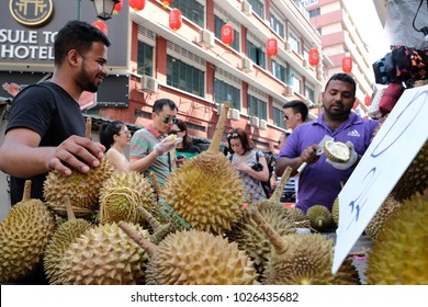 Kuala Lumpur, Malaysia 1 Feb 2018 : Tourists enjoying Musang King and D24 durian (king of fruit) at street stall Petaling Street, Kuala Lumpur.
