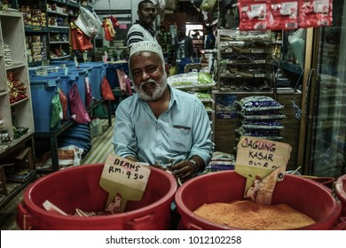 Kuala Lumpur, Malaysia 1 Jan 2018 :  Indian muslim shopkeeper selling spice for curry cooking at  Chow Kit Market.