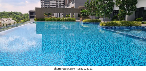 Kuala Lumpur, Malaysia - 1 Jan. 2021 :  Swimming pool facilities view at 5th floor building of modern condominium residential area