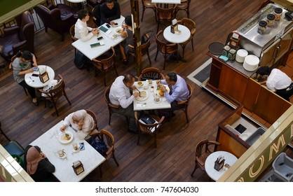 Kuala Lumpur, Malaysia - 1 Nov. 2017 : View of people eating in an elegant restaurant inside shopping mall in Kuala Lumpur.