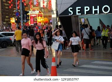 Kuala Lumpur, Malaysia 10 Jan 2019: Street scene of people during rainy day in Bukit Bintang shopping area.