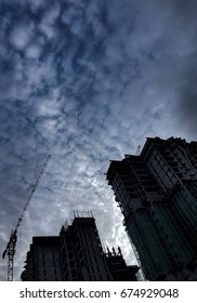 KUALA LUMPUR, MALAYSIA 10 JULY 2017: Silhouette. A high rise building is under construction with a view of the blue sky and clouds at Kuala Lumpur city.