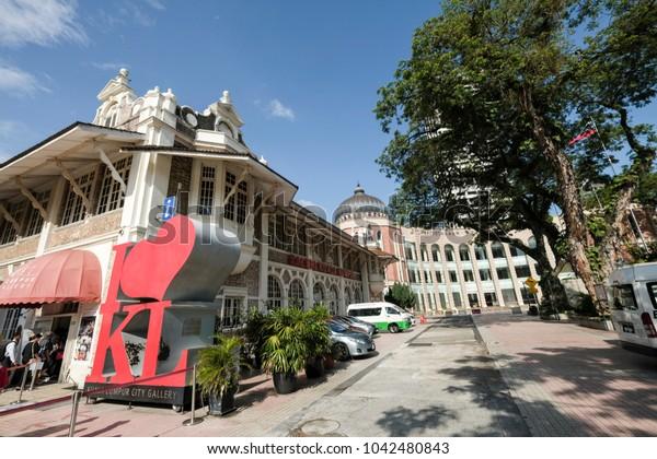 "Kuala Lumpur, Malaysia - 10/3/2018 : Tourists take turn to take photo at the ""I Love KL"" replica located in front of the City Gallery Kuala Lumpur"