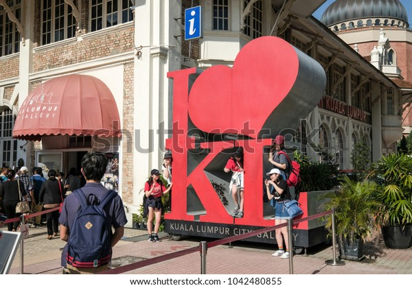 "Kuala Lumpur, Malaysia - 10/3/2018 : Tourists take turn to take photo at the ""I Love KL"" replica located in front of the City Gallery Kuala Lumpur"