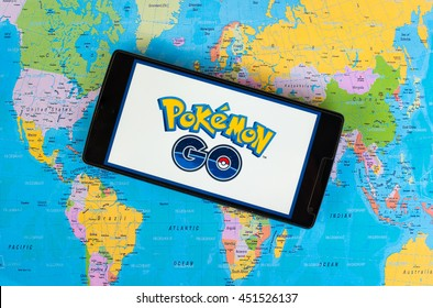 KUALA LUMPUR, MALAYSIA - 12 JULY 2016: Pokemon Go is a free-to-play, GPS based augmented reality mobile game . The game become hits around the world. (picture with world map background).
