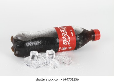 KUALA LUMPUR, MALAYSIA - 12th August 2017 : Plastic bottle of Coca-Cola. Coca Cola drinks are produced and manufactured by The Coca-Cola Company, an American multinational beverage corporation.