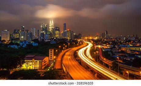 KUALA LUMPUR, MALAYSIA - 13TH JANUARY 2014; Dramatic scenery of elevated highway heading towards Kuala Lumpur city centre during sunset.