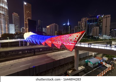 kuala lumpur, malaysia - 14 february 2020. new attraction at kuala lumpur, saloma link bridge lit at night aerial view. close up shot.