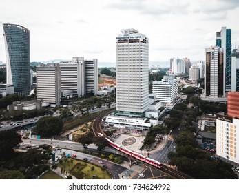 Kuala Lumpur, Malaysia - 14 Oct 2017 : Aerial view of Dewan Bandaraya Kuala Lumpur building with LRT train moving