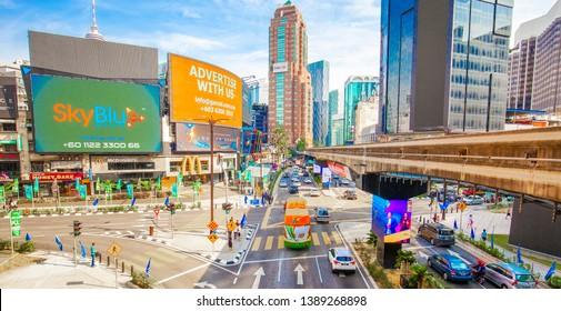 KUALA LUMPUR, MALAYSIA - 15 April 2019: Kuala Lumpur city center skyline wide photo. Advertising billboards with advertisement information.