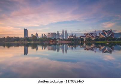 KUALA LUMPUR, MALAYSIA - 15 JUNE 2018 : Lake Titiwangsa Park cultural art center foreground on Kuala Lumpur skyline business center