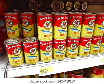 Kuala Lumpur, Malaysia - 15 June 2019 : Selection of AYAM BRAND Sardines / Mackerel in tomato sauce display for sell in the supermarket shelves - Image
