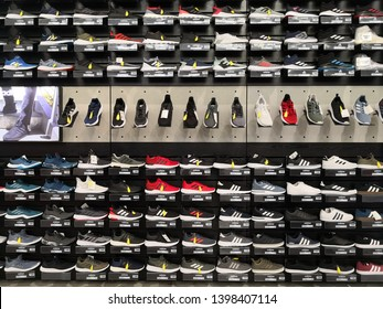 Kuala Lumpur, Malaysia - 15 May 2019; View of various size and brand name ADIDAS shoes on shelves at Adidas store
