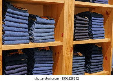 Kuala Lumpur, Malaysia - 16th September 2019: rows of LEVI'S brand denim jeans outfit on shelves in outlet or official store. LEVI Strauss is a famous american clothing company from California.