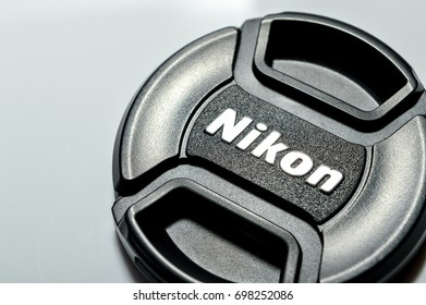 KUALA LUMPUR, MALAYSIA; 17 AUGUST, 2017- Nikon brand logo on lens cover or lens cap on white background. Nikon is one of poppular brand of imaging products headquartered in Tokyo, Japan
