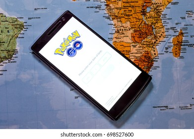 KUALA LUMPUR, MALAYSIA - 17 AUGUST 2017: Pokemon Go is a free-to-play, GPS based augmented reality mobile game . The game become hits around the world. (picture with world map background).