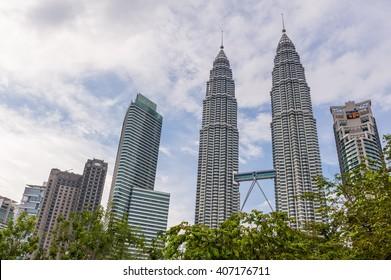 Kuala Lumpur, Malaysia, 17 Nov 2013: Famous landmark towering Petronas Twin Towers with blue sky.