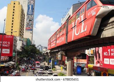 KUALA LUMPUR, MALAYSIA - 17th July 2017: Train of KL Monorail in the Bukit Bintang district of Kuala Lumpur over busy city background