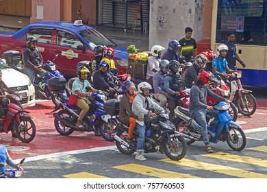 KUALA LUMPUR MALAYSIA - 18 NOVEMBER 2017:  More and more people travel by motorcycle instead of a car, due to the fuel price increase in Malaysia.