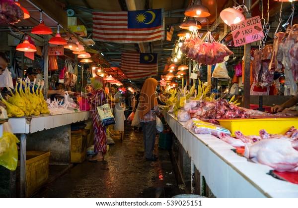 KUALA LUMPUR, MALAYSIA - 18TH DECEMBER 2016;Unidentified shoppers with their purchases in Bazaar Baru Chow Kit, Kuala Lumpur, Malaysia.