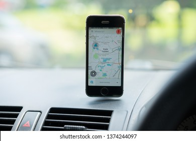 KUALA LUMPUR, MALAYSIA - 19 APRIL 2019 : GPS-based map navigation and traffic information application Waze running on an iPhone inside a car.