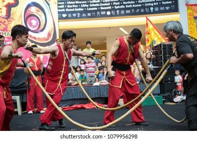 KUALA LUMPUR, MALAYSIA - 19 OCT 2014 : Chinese traditional stuntman bending bamboo spear with their throats at VIVA HOME shopping mall in Kuala Lumpur, Malaysia.