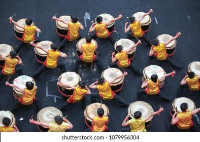 KUALA LUMPUR, MALAYSIA - 19 OCT 2014 : Teenagers performing chinese lion dance drum rhythmic show and dance at VIVA HOME shopping mall in Kuala Lumpur, Malaysia.