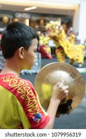 KUALA LUMPUR, MALAYSIA - 19 OCT 2014 : Young lion dance orchestra cymbals players performing at VIVA HOME shopping mall in Kuala Lumpur, Malaysia.