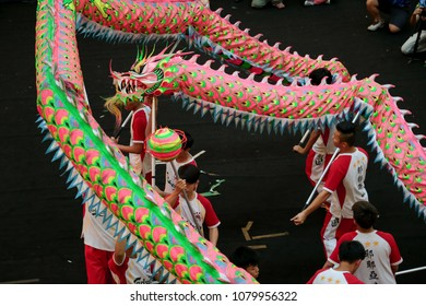 KUALA LUMPUR, MALAYSIA - 19 OCT 2014 : Group of teenagers orchestrating traditional dragon dance at VIVA HOME shopping mall in Kuala Lumpur, Malaysia.