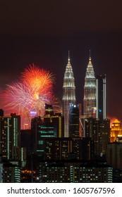 KUALA LUMPUR, MALAYSIA - 1ST JANUARY 2020; Fireworks explode near Malaysia's landmark Petronas Twin Towers during New Year celebrations in Kuala Lumpur.