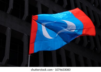 Kuala Lumpur, Malaysia 2 April 2018 : Parti Keadilan Malaysia (PKR) political flag with dark city background in conjunction of the Malaysian 14th general election.