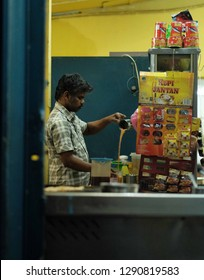 Kuala Lumpur, Malaysia 20 Jan 2019 : Indian restaurant worker preparing teh tarik,a popular milk tea in Malaysia.