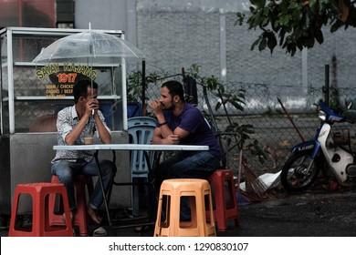 Kuala Lumpur, Malaysia 20 Jan 2019 : Street scene of people having conversation at road side restaurant in Kuala Lumpur.