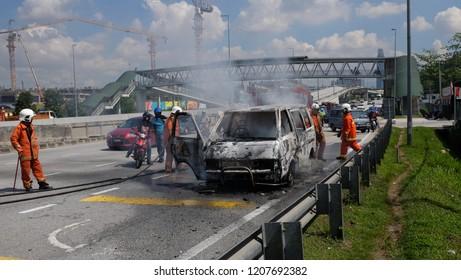 Kuala Lumpur, Malaysia - 20 October 2019 : Malaysia fire bfighter team putting off car fire at Sungai Besi Highway.