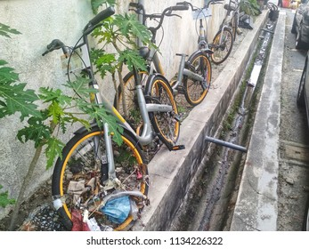 Kuala Lumpur, Malaysia - 2018. Damaged and abandoned oBike bicyle. oBike is stationless bicycle-sharing system with operations in several countries in Asia.