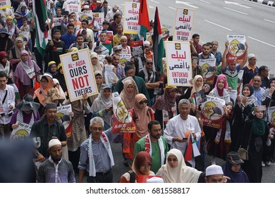 "KUALA LUMPUR, MALAYSIA - 21 July 2017:Protesters gather to protest the closure of Al-Aqsa Mosque and holding banners Save Palestine ""Free Al-aqsa"" against Israeli Government's at Tabung Haji Building"