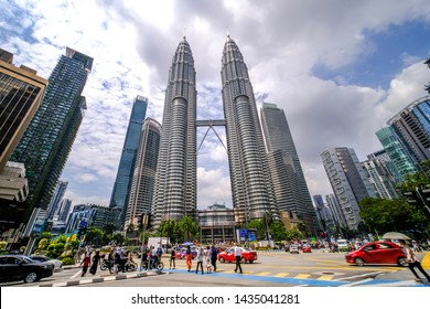 Kuala Lumpur, Malaysia - 21/6/2019 : Wide view of the famous twin tower Petronas Suria KLCC with beautiful cloudy blue sky on a bright sunny day