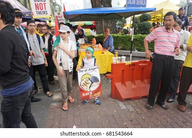 """KUALA LUMPUR, MALAYSIA - 21st July 2017 : Protesters gather to protest the closure of Al-Aqsa Mosque and holding banners """"Save Palestine"""" """"Free Al-aqsa"""" against Israeli Government's."""