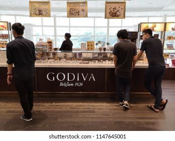 Kuala Lumpur, Malaysia 22 July 2018 : Tourist buying a Godiva ice cream in Suria KLCC. Godiva is a premium brand ice cream from Belgium since 1926.