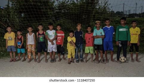 Kuala Lumpur, Malaysia 22 June 2018 : Refugee children of various ethnicity playing football in Selayang, near Kuala Lumpur.