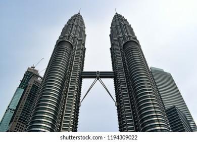Kuala Lumpur,  MALAYSIA - 23 April 2017 : The Petronas Towers, also known as the Petronas Twin Towers, are twin skyscrapers in Kuala Lumpur, Malaysia.