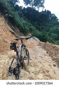 Kuala Lumpur, MALAYSIA - 23 January 2018: A bicycle on a muddy trail.