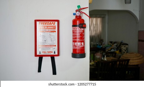 Kuala Lumpur, Malaysia - 23 Sept 2018: Eversafe brands fire blanket and fire extinguisher mounted in the wall in the house. Fire safety alert.