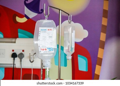 Kuala Lumpur, Malaysia - 23th Febuary 2018 : A bottle of NaCl hanging for paediatric patient in ward for medication purpose. Image has grain or blurry or noise and soft when view at full resolution.