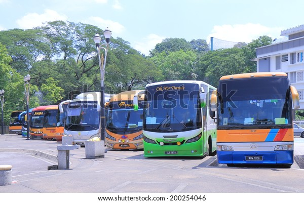 KUALA LUMPUR MALAYSIA - 24 May, 2014: Tour buses wait for passengers at National Mosque. Over 25 million people visited Malaysia in 2013.