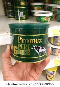 Kuala Lumpur, Malaysia - 25 May 2018: Hand holding a Pure Ghee or cow fats oil brands Promex in supermarket